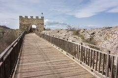 Wooden bridge and Gate of medieval fortress. Ovech Fortress, Provadia, Bulgaria. Blue sky Royalty Free Stock Photo