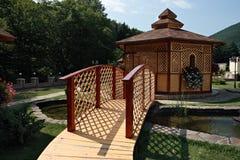 Wooden bridge and gazebo Stock Images