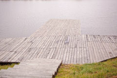 Wooden bridge that goes to the river Stock Photography