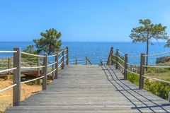 Wooden bridge going to the sea. Stock Photography