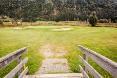 Wooden bridge in golf course. An old wooden bridge on an idyllic meadow or a beautiful golf course Stock Photos