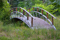 Wooden bridge on the grass Royalty Free Stock Image