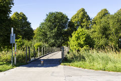 Wooden bridge in green garden in the afternoon. Wooden bridge in garden in the afternoon Royalty Free Stock Image