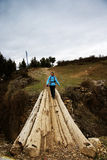 Wooden bridge and hiker Royalty Free Stock Photography