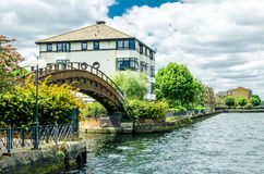 A wooden bridge and houses at the London Docklands Royalty Free Stock Photo