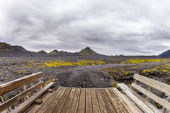 Wooden bridge in Iceland on hill background with cloudy sky Royalty Free Stock Image