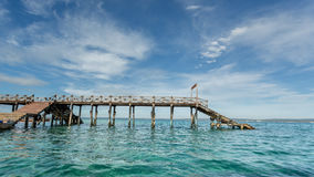 Wooden bridge on the Indian Ocean Royalty Free Stock Image