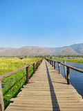 Wooden bridge in Inke Lake Myanmar. Long wooden bridge at floating garden, Inle Lake, Myanmar (Burma Stock Photo