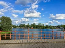 Wooden bridge with iron fence in landscape Royalty Free Stock Images