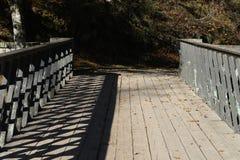 Wooden bridge with iron handle stock images