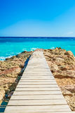 Wooden bridge juts out into  of the sea Royalty Free Stock Photography