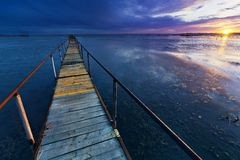 Wooden bridge in the lake Stock Images