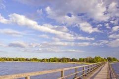 Wooden bridge on lake Stock Image