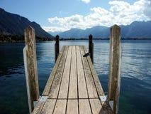 Wooden bridge on lake. Wooden bridge on leman lake in switzerland Royalty Free Stock Photos