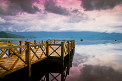 The wooden bridge in the lake Royalty Free Stock Images