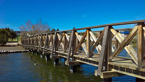 Wooden Bridge On The Lake Of The Ducks Stock Photo