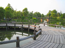 Wooden bridge in the lake. In the park Stock Photography