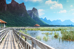 Wooden bridge and lake in Sam Roi Yod National Park Royalty Free Stock Photography