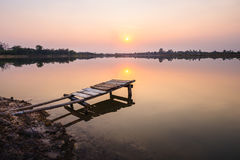 Wooden bridge at the lake on sunset Royalty Free Stock Photos