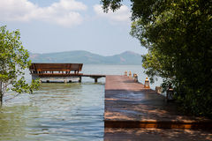 The wooden bridge landing to pavilion in the sea Royalty Free Stock Photo