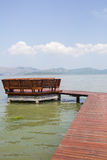 The wooden bridge landing to pavilion in the sea Stock Image