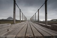 Bridge in landscape along hiking trail in iceland. Wooden bridge in landscape along hiking trail in iceland Stock Photos