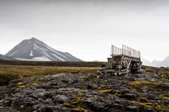 Wooden bridge in landscape along hiking trail. In Iceland with obsidian Royalty Free Stock Photo