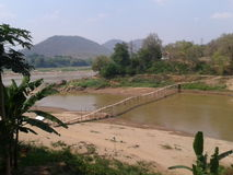 Wooden bridge at Laos Stock Photography