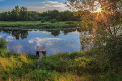Wooden bridge laundry rinse, a small river. Summer evening Stock Photography