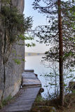Wooden bridge leading around rock cliff at Faangsjoen in Sweden Stock Image