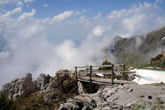 The wooden bridge leading to the clouds in Swiss Alps Royalty Free Stock Photography