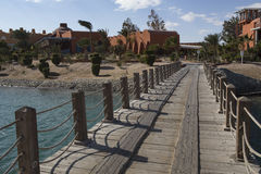 Wooden bridge leading to the hotels. Royalty Free Stock Image