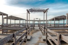 Wooden bridge leading to seaside. Cloudy sky Stock Photography