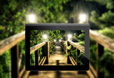 Wooden Bridge lit by lanterns Royalty Free Stock Photography