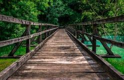 Wooden bridge. Long wooden bridge over the river Royalty Free Stock Image