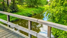 Wooden bridge looking out on the river in a forest landscape. A wooden bridge looking out on the river in a forest landscape stock image