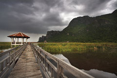 Wooden Bridge in lotus lake at khao sam roi yod national park Stock Photo