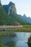 Wooden Bridge in lotus lake Stock Photo