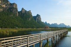 Wooden Bridge in lotus lake Stock Image