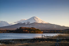 A wooden bridge on the meadow with the lake and Mount Fuji. Stock Images