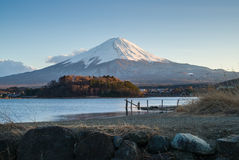 A wooden bridge on the meadow with the lake and Mount Fuji. Royalty Free Stock Photo