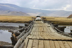 Wooden bridge in Mongolia. Old wooden bridge in central Mongolia Stock Image