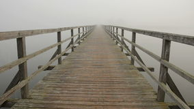 Wooden bridge and morning mist Stock Photography