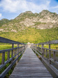 Wooden bridge through the moutain Stock Photos