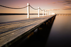 Wooden bridge. Narrabeen wooden bridge during golden hour - Winter period in Sydney, Australia Royalty Free Stock Images