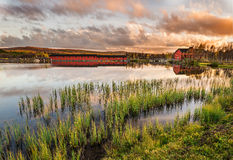Wooden bridge on Narsjoen lake in Norway at sunset Stock Photography