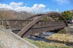 Wooden bridge near Kawaguchi lake in Yamanashi, Japan. Wooden bridge across tha canal near Kawaguchi lake and Fuji mountian in late winter of Yamanashi Stock Photos