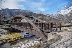 Wooden bridge near Kawaguchi lake in Yamanashi, Japan. Wooden bridge across tha canal near Kawaguchi lake and Fuji mountian in late winter of Yamanashi Stock Image