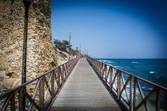 Wooden bridge near the sea Royalty Free Stock Photos