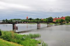 Wooden bridge on Nogat river in Malbork, Poland Royalty Free Stock Images
